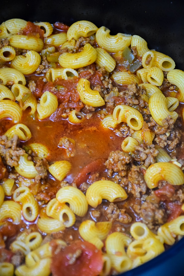 Comfort food in a stock pot, pasta, tomato sauce and beef