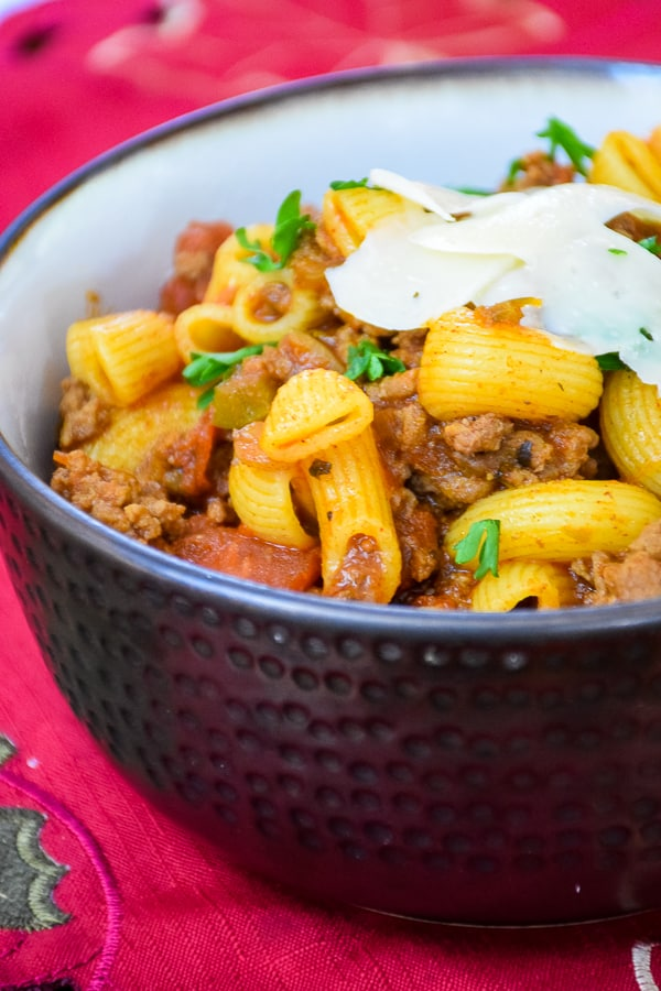 Classic Beef Goulash is a recipe I grew up that others may call American Chop Suey. It is a basic, easy recipe made with ground beef, tomato sauce, macaroni, and spices. This is all simmered together making a delicious comfort food meal for your family!