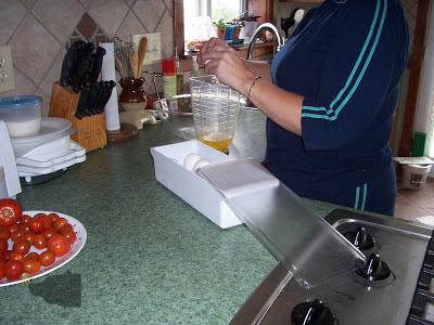 adding wet ingredients to blender