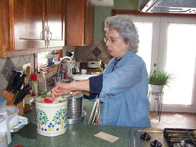 mom measuring dry ingredients into flour sifter