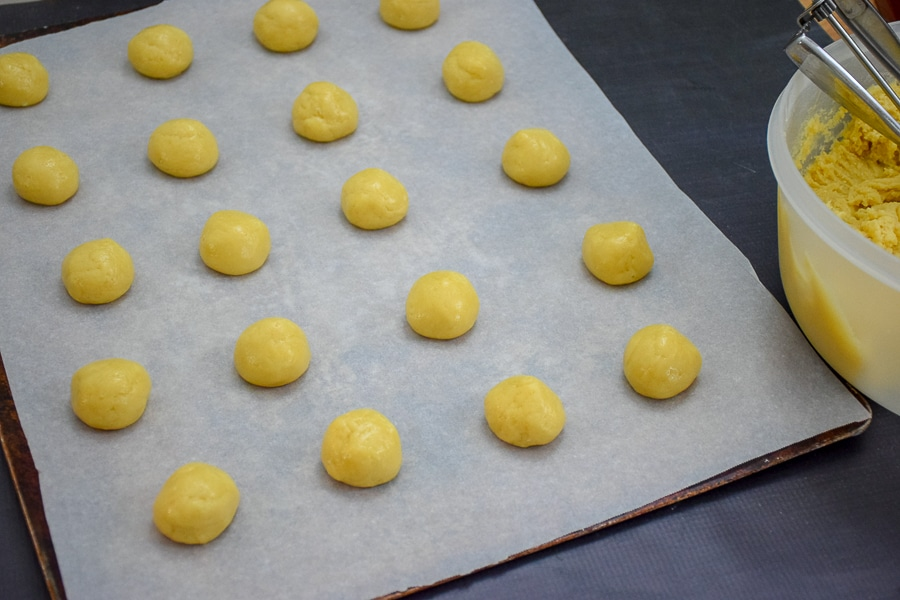 "Dough is shaped into 1"" balls and placed 1"" apart on parchment lined cookie sheet."