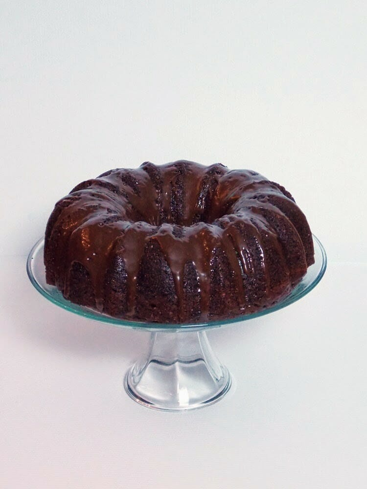 Rich Mocha Cake, sounds sinful but only 5 Weight Watcher Points Plus! Deep dark chocolate flavor enhanced with coffee and Kahlua in the batter as well as doused with Kahlua on top after baking then glazed with a chocolate glaze.