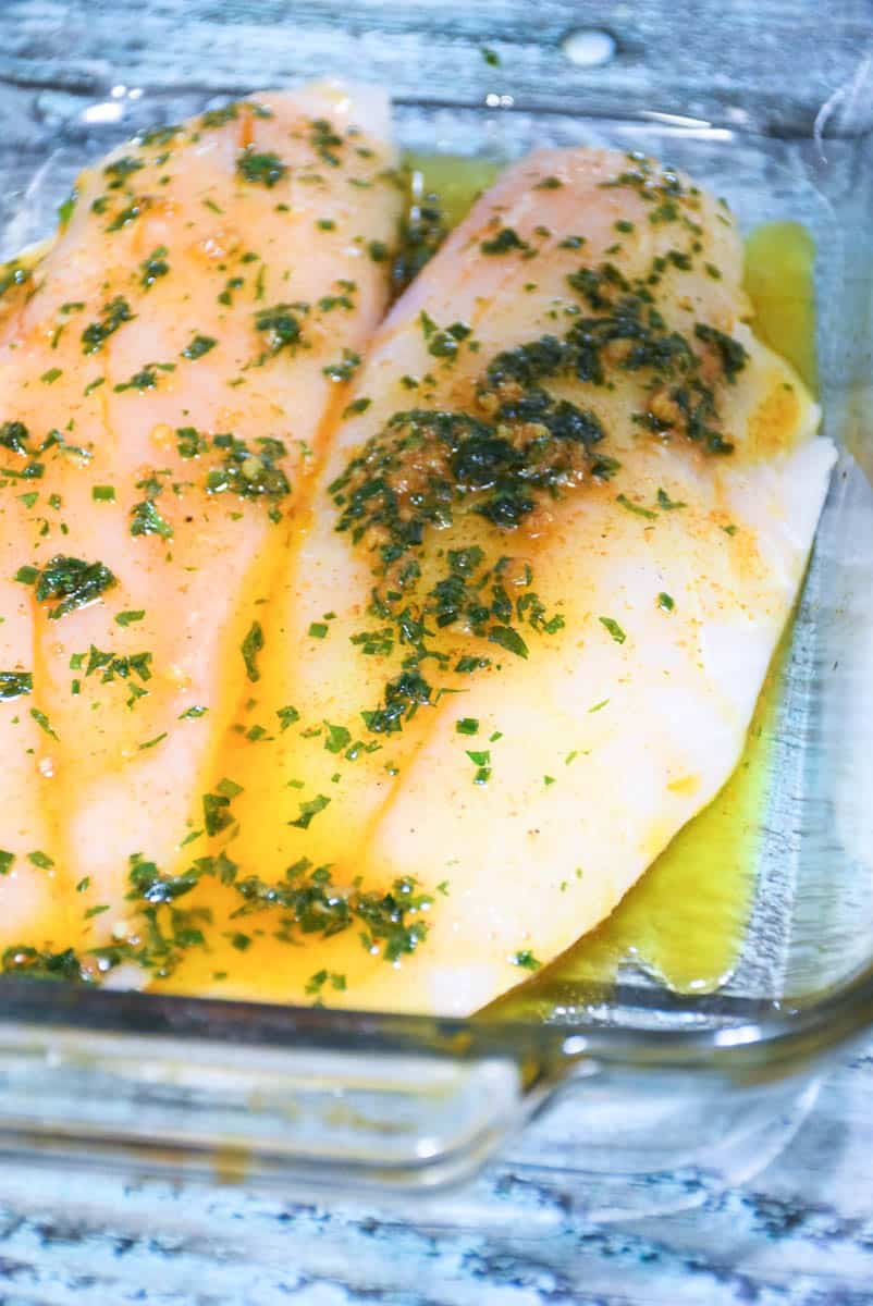 Filets in baking dish with butter and herbs