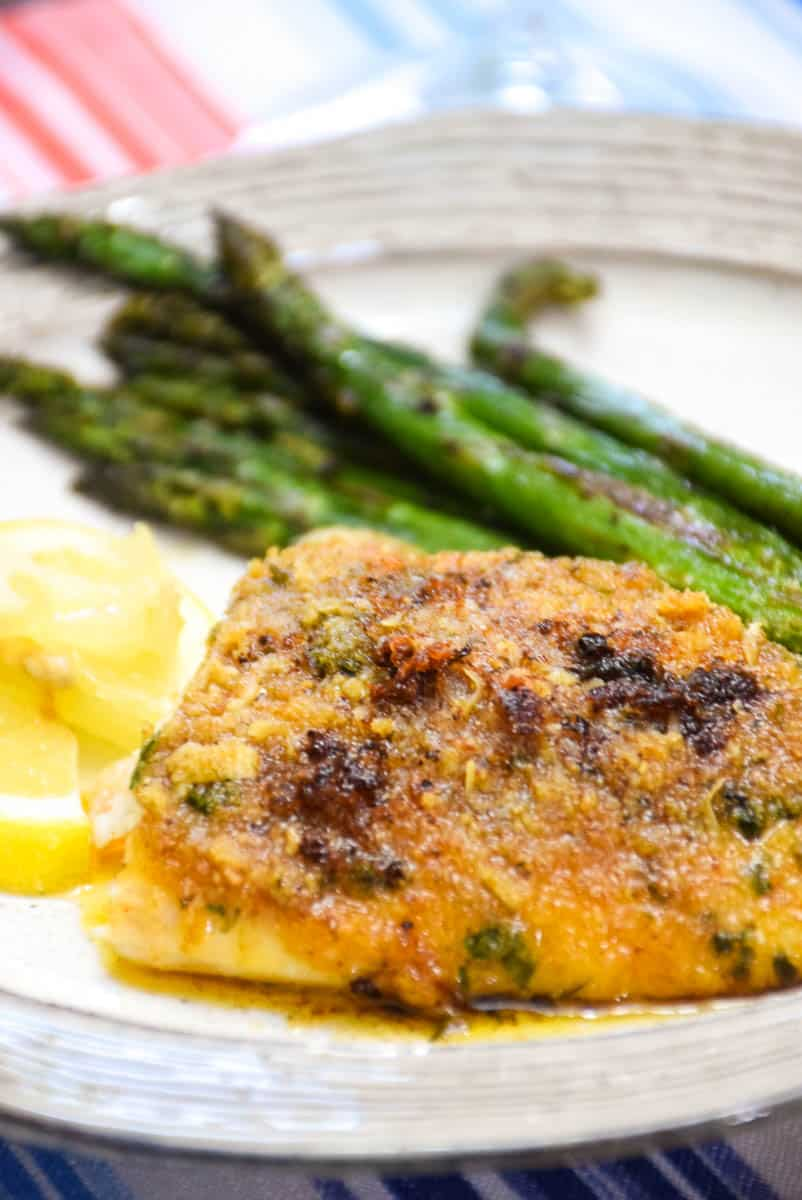 Baked Red Snapper with Garlic and a side of asparagus with lemon wedges