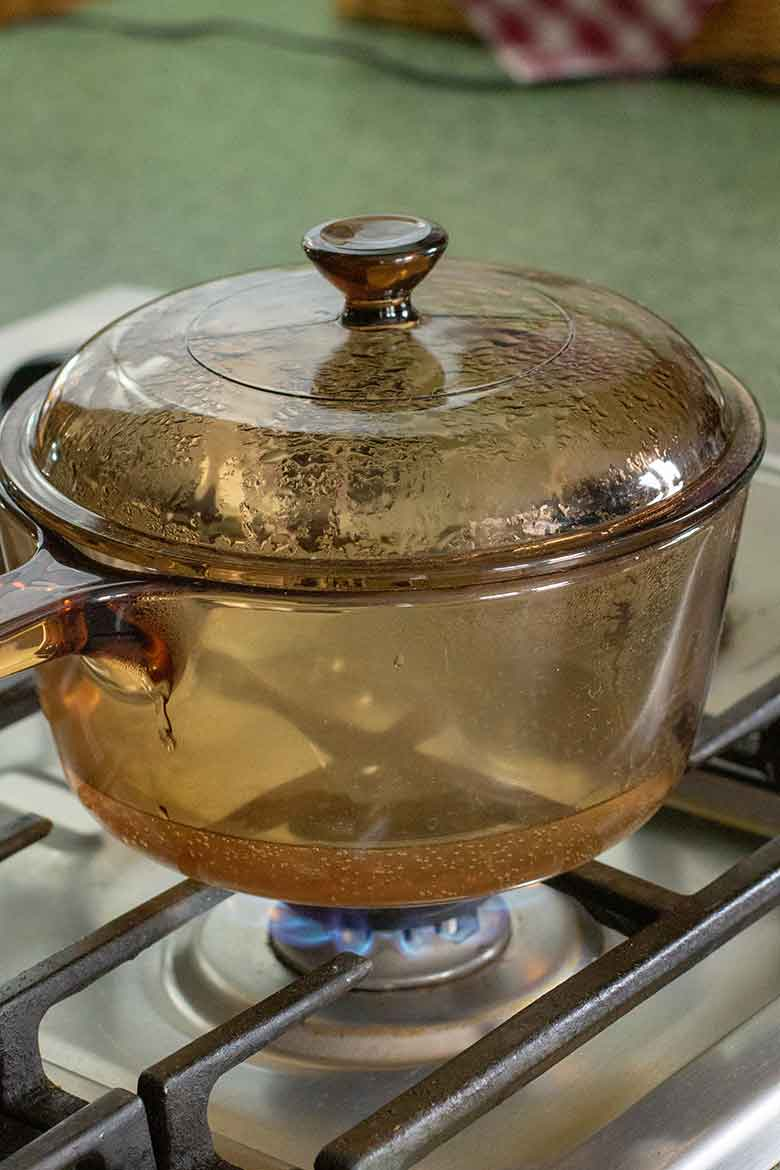 Bringing a pot of water to boil on a gas cooktop