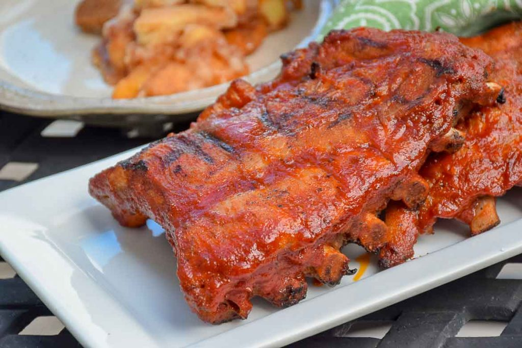 Stove-Top Baby Back Ribs after they have been grilled with barbecue sauce on a serving platter.