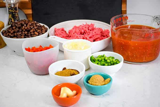 chili ingredients on a white countertop