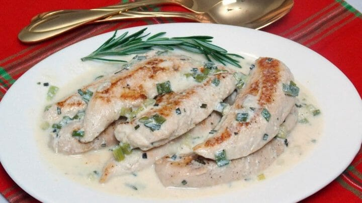 Chicken with Rosemary Sauce on a cream plate with a red napkin