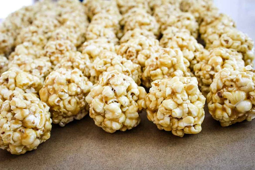 sweet salted caramel popcorn balls on parchment paper