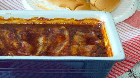 Bourbon Bacon Baked Beans in a blue casserole dish