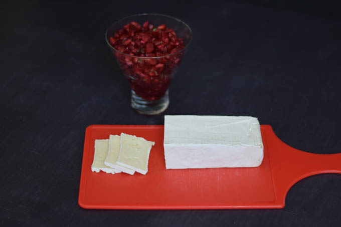 brie slices with cranberry relish in the background