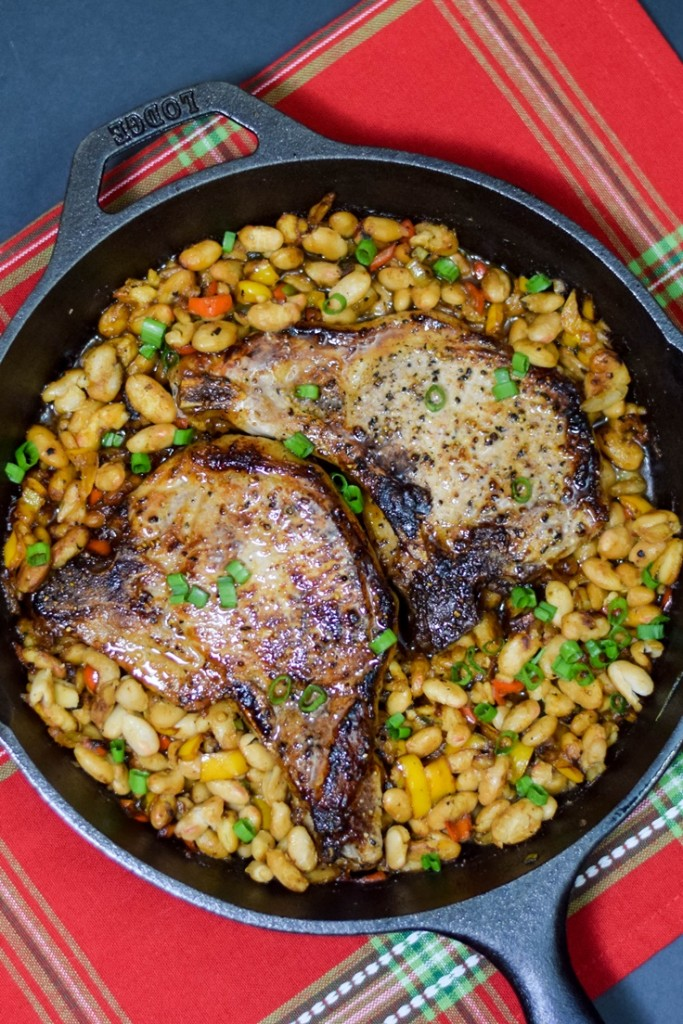 Bourbon Glazed Pork Chops in a cast iron skillet