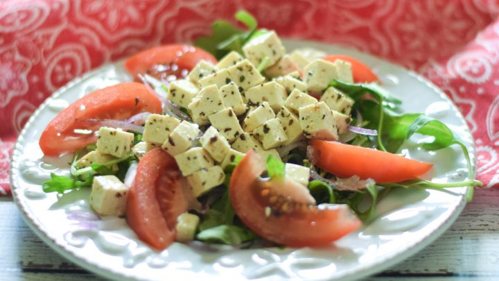 Marinated Tofu Salad Recipe on a blue plate with a red and white napkin