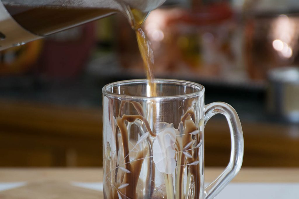 Pouring the coffee in the mug