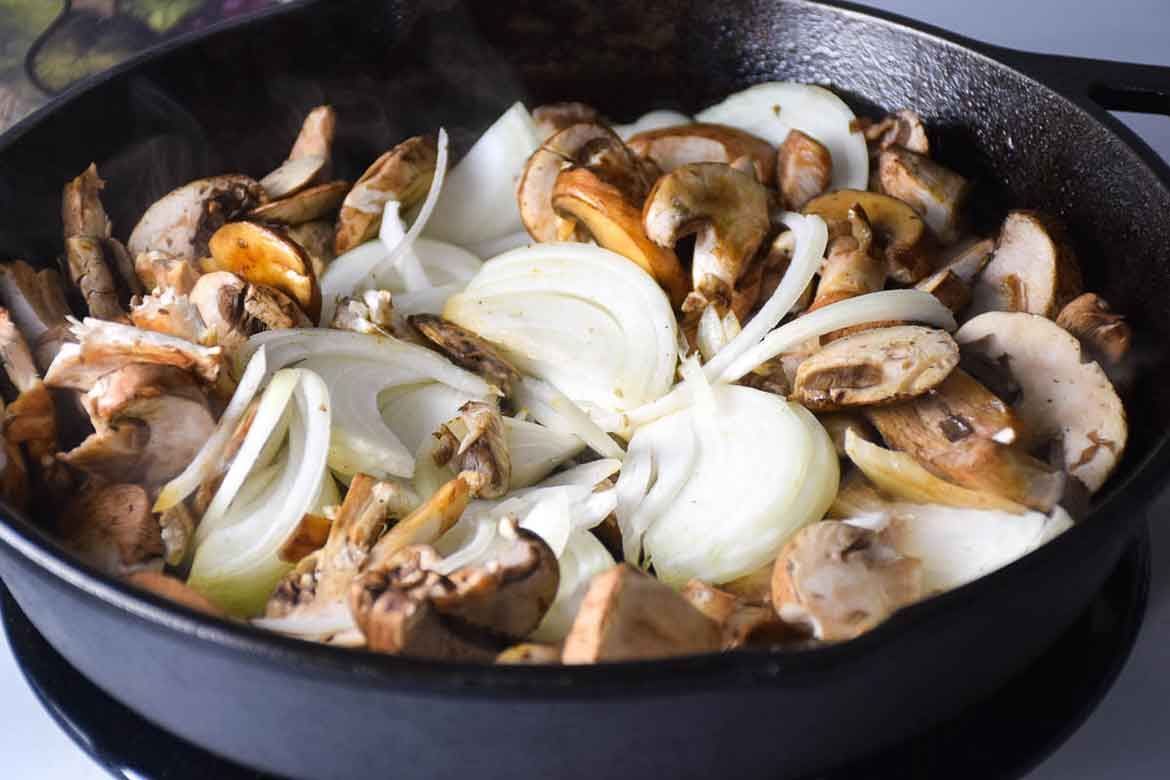 Sauteing onions and mushrooms in skillet