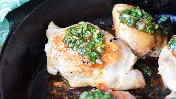 Chicken Thighs with Cilantro Sauce in skillet up close view