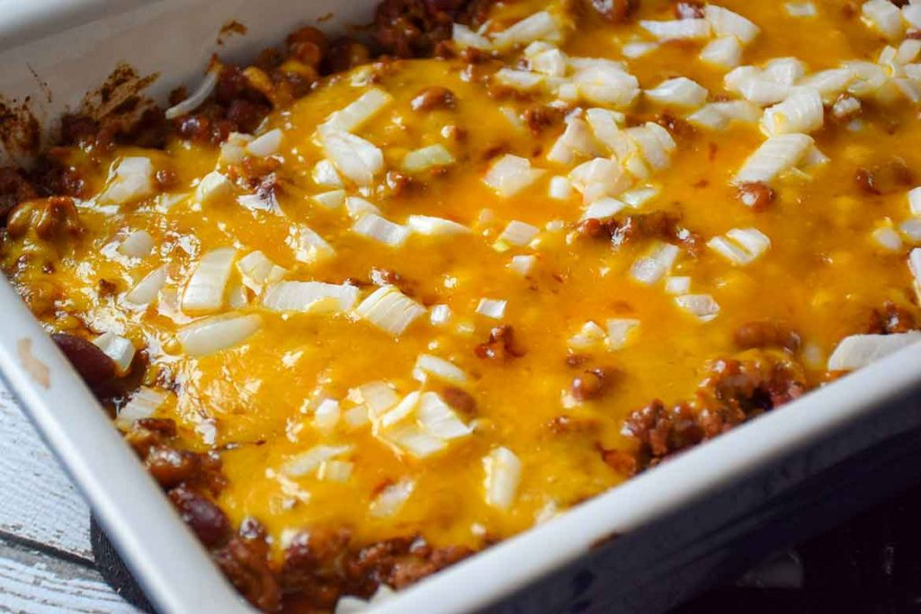 fully baked chili dog casserole in baking dish before serving