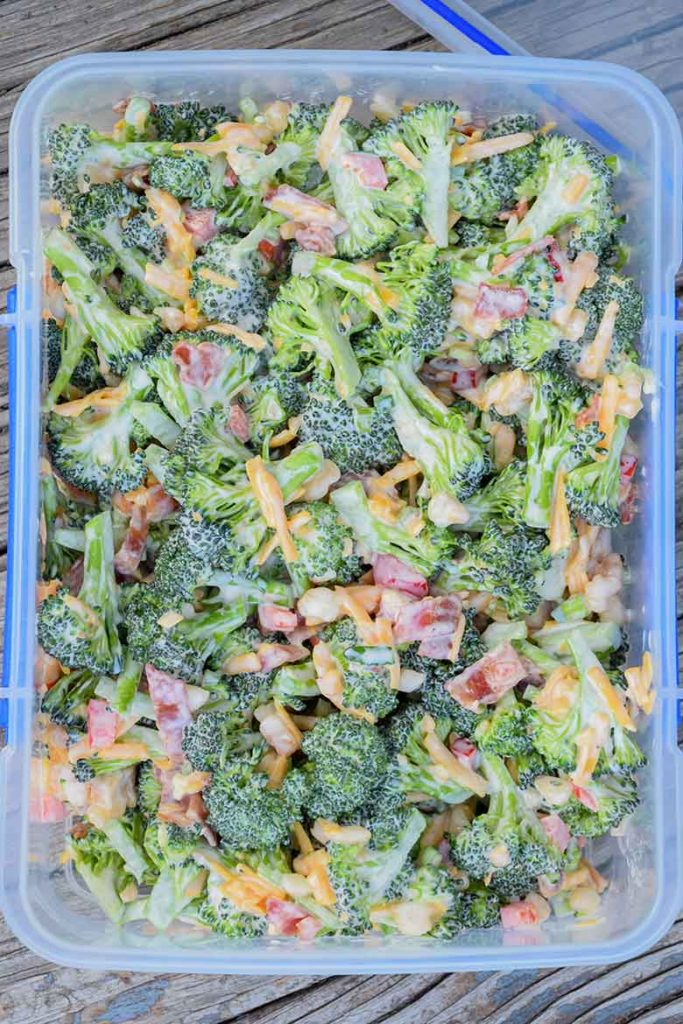 Overhead view of salad in clear storage container