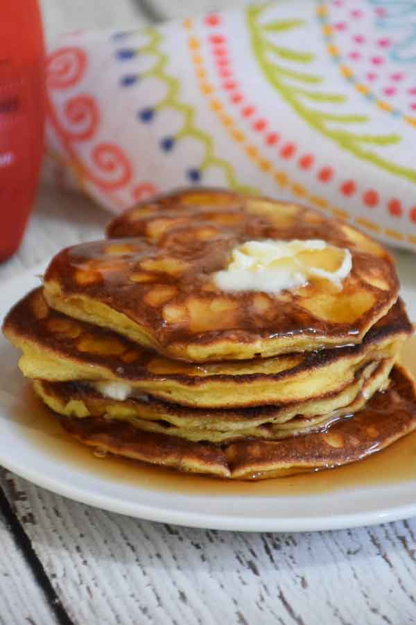 A stack of Keto Pancakes with butter and syrup on top