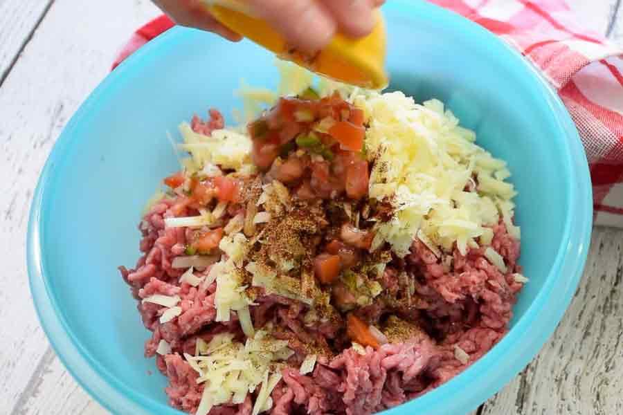 adding salsa to the ground beef