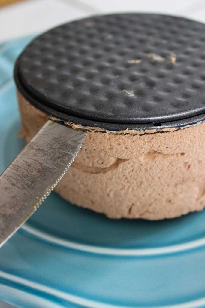 Removing chocolate peanut butter cheesecake from springform pan