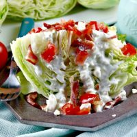 Wedge Salad with Blue Cheese Dressing Topped with Bacon & Tomatoes