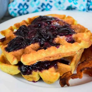 keto blueberry waffles with sugar free blueberry sauce and a side of bacon