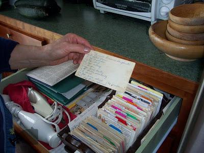Mom holding the deep fried doughnut recipe card