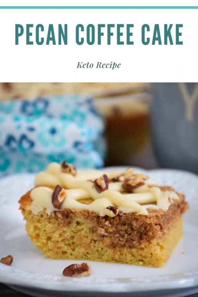Pecan Coffee Cake - tender baked cake with a cinnamon swirl and icing drizzle on a plate - pinnable image