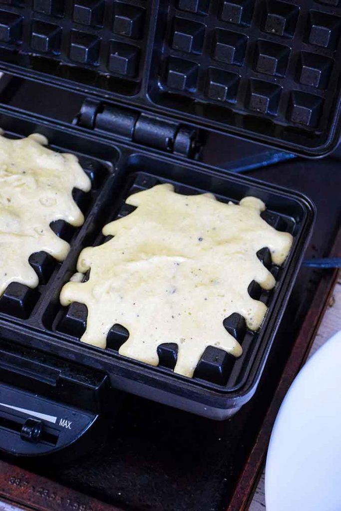 Batter added to hot waffle iron