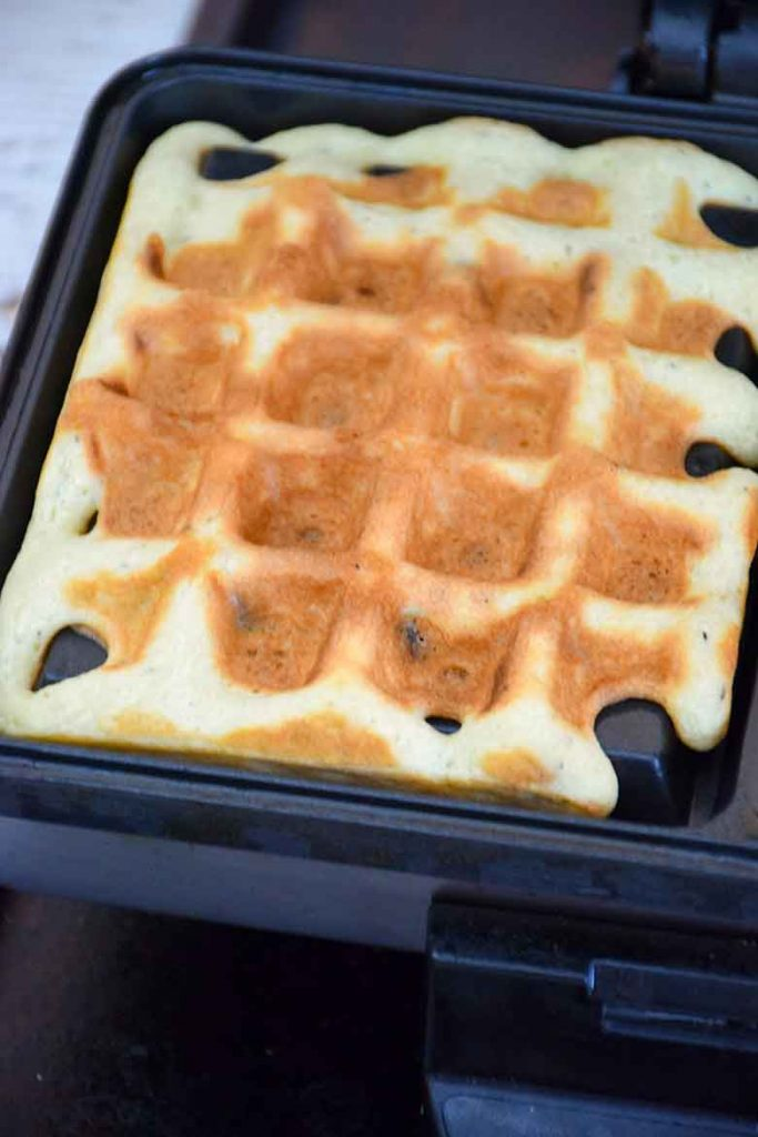 Cooked waffle sitting in waffle iron