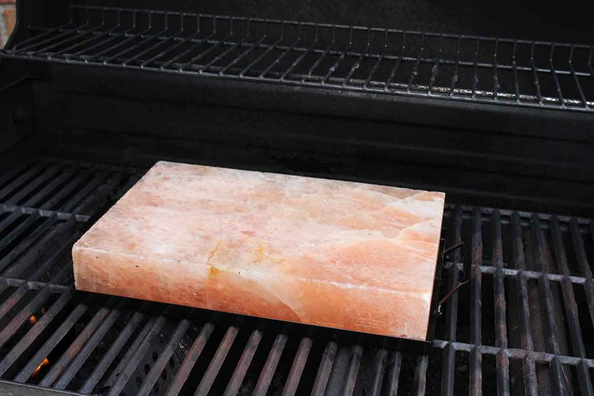 Pink Himalayan Salt Block heating on grill