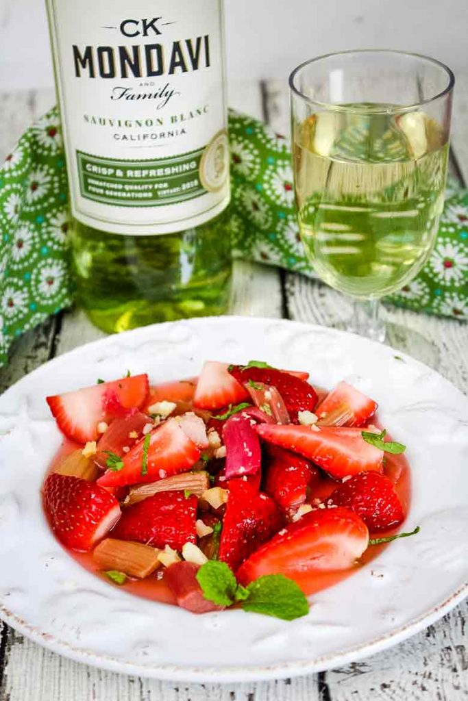 Strawberry Rhubarb Salad on a seashell plate with CK Mondavi Sauvignon Blanc pairing