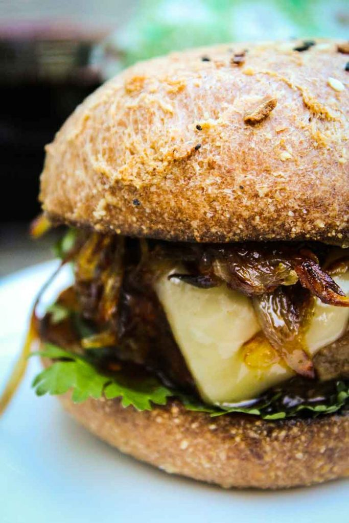 up close image of Chipotle Burger with Crispy Shallot Topping