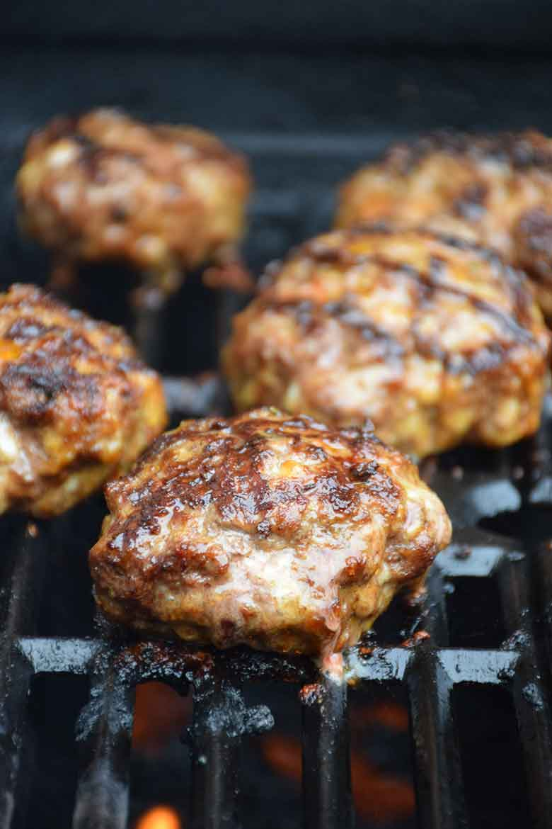 burger cooking on gas grill