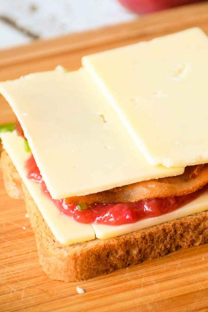 bread slice with cheese, rhubarb recipe for sauce layer, bacon, jalapeno and cheese