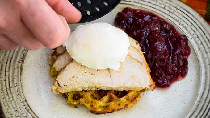 Placing the egg on the Thanksgiving Eggs Benedict