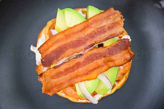 Chaffle with bacon, avocado, and cream cheese spread