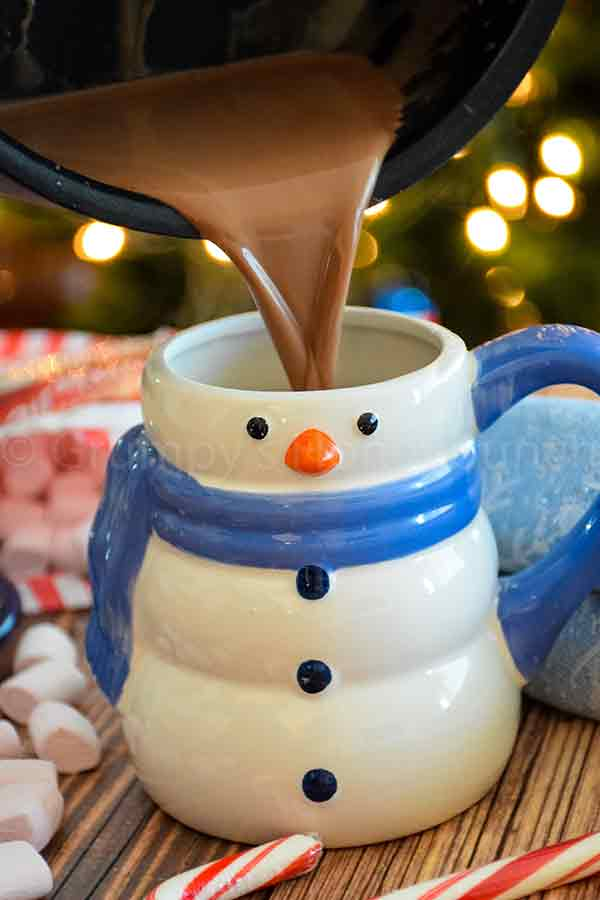 pouring the beverage in a snowman mug
