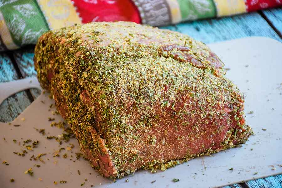 uncooked roast with dry rub