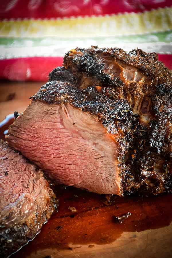 Air Fryer Roast Beef sliced on a wooden cutting board