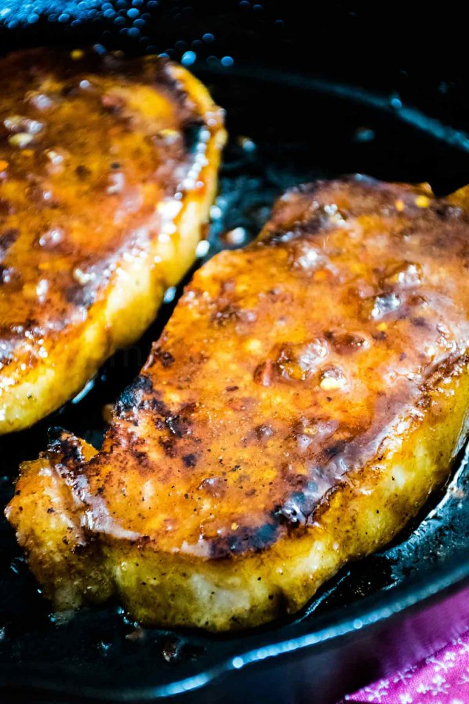 Honey Garlic Pork Chops for Two in a cast iron skillet