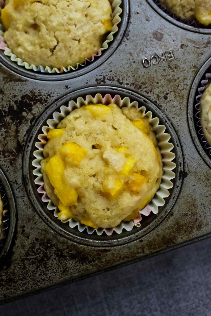 overhead view of baked muffins in the muffin pan