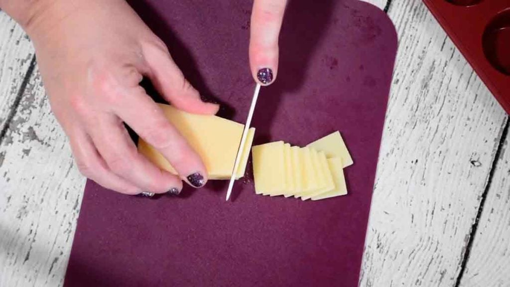 slicing the parmesan cheese